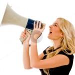 cutcaster-photo-100211561-portrait-of-woman-shouting-in-loud-speaker