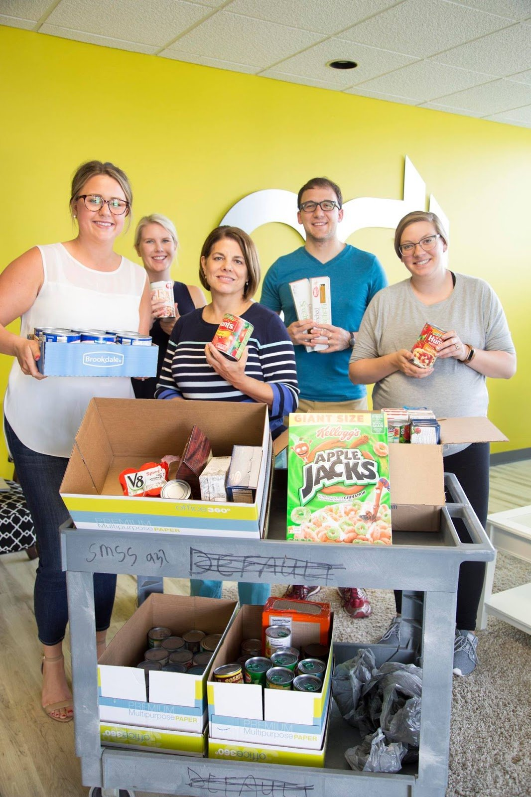 OneClick Team collecting canned foods