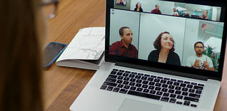 Woman works remote from home, video conferencing with coworkers