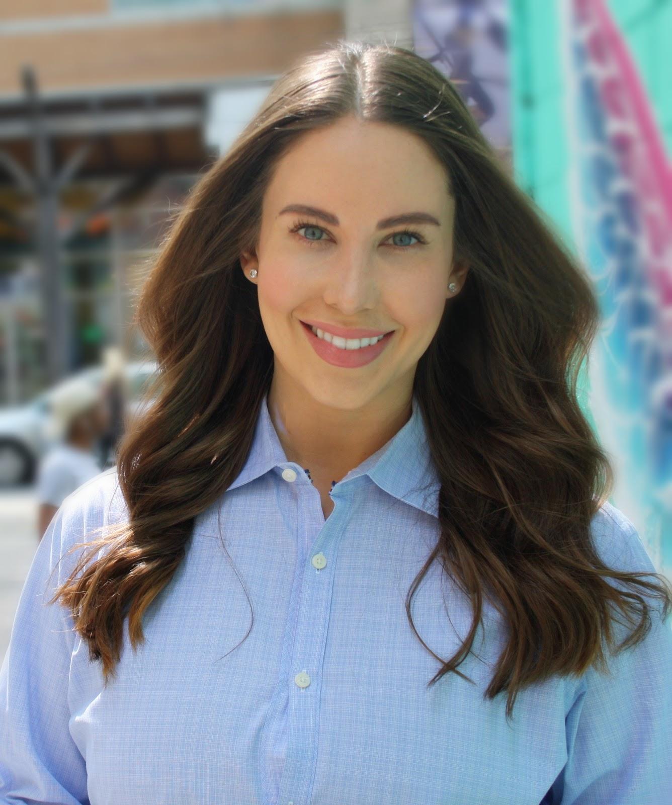 A headshot of Dr. Sarah Saska, CEO of Feminuity.