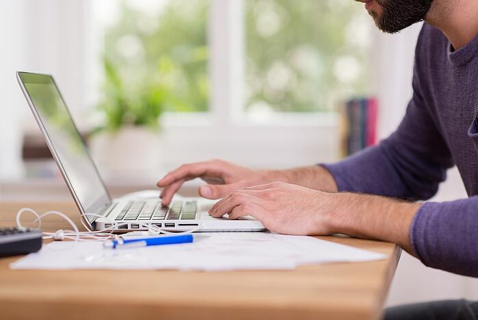 man working remotely to help with work-life balance