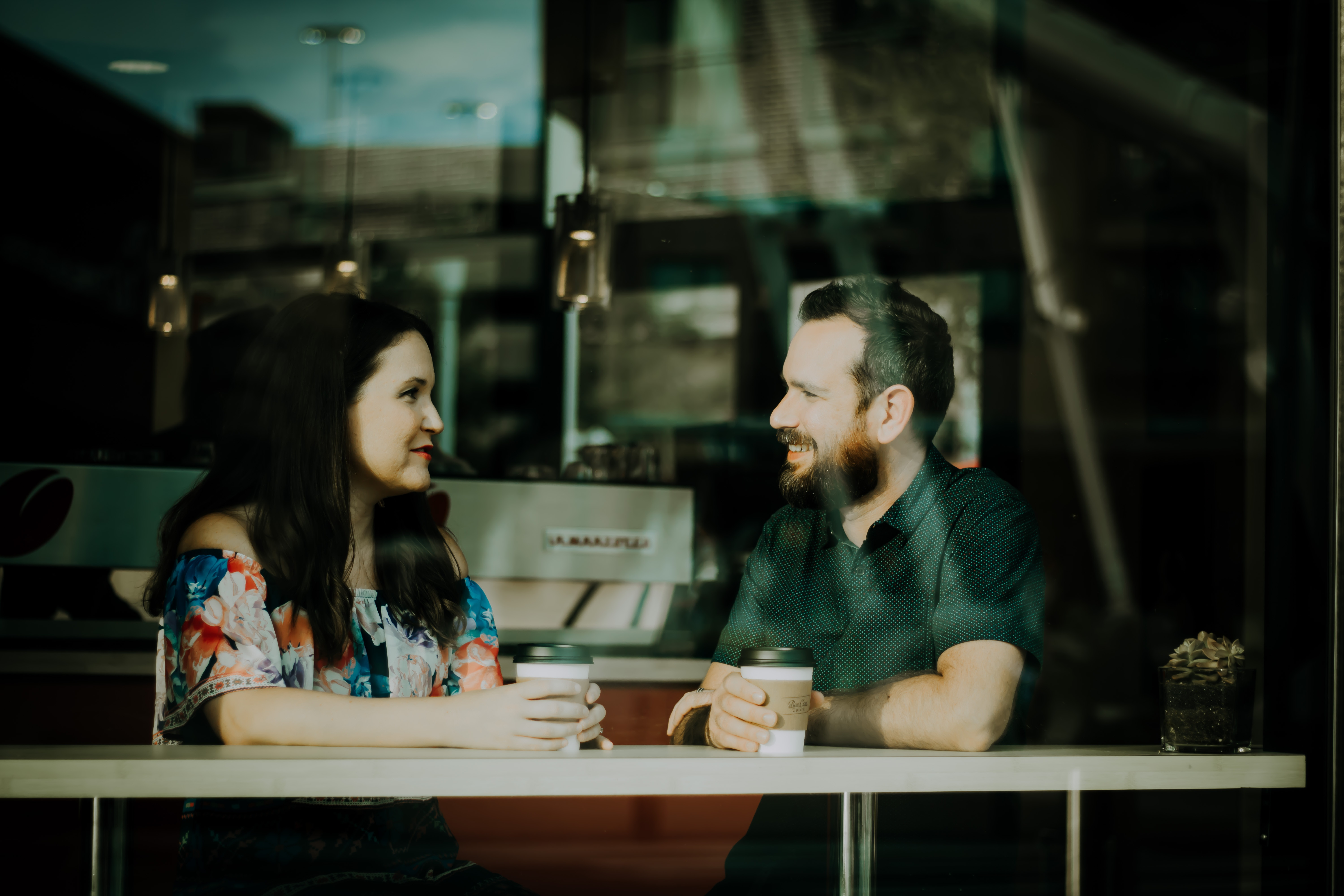 Pair of people talking over coffee
