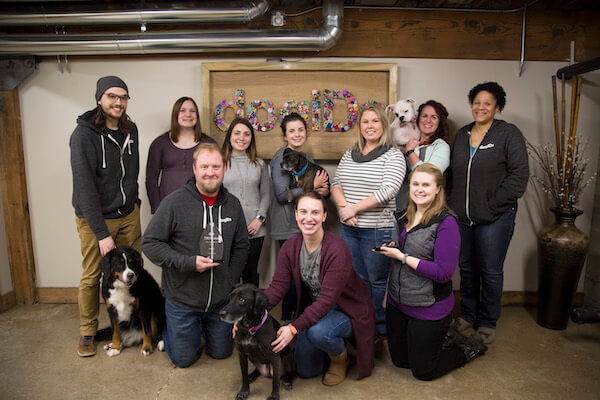 Members of the dogIDs pack pose with dogs and their two TINYawards.