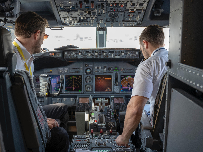 two-pilots-sitting-inside-plane-2064123