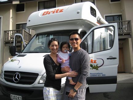 Alice, David and Keira picking up their Campervan in New Zealand